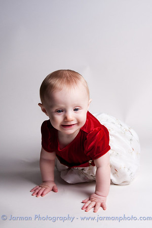 Emma and I had a fun time taking these photos even though she kept trying to crawl off the seamless paper.